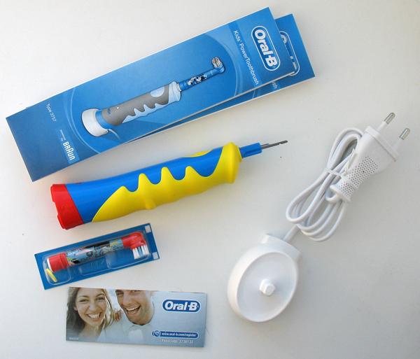 Электрическая зубная щетка браун германия